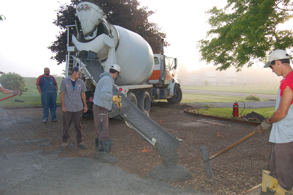 pouring the cement for the parking pad