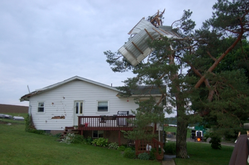 damaged home at Robert J. Yoder farm.