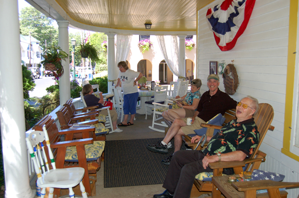 Friends gather on the porch by Bruce Stambaugh