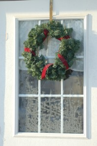 Wreath on frosty window by Bruce Stambaugh