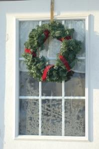 Wreath on frosty window by Bruce Stambaugh