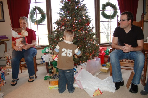 Opening gifts by Bruce Stambaugh