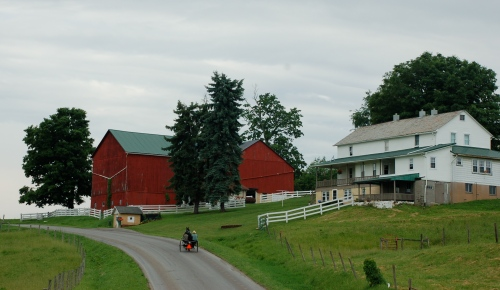 Red barn white house by Bruce Stambaugh