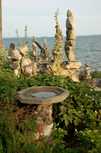 Lakeside rocks and flowers by Bruce Stambaugh