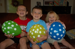 Kids and balloons by Bruce Stambaugh