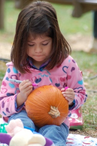 Girl and pumpkin by Bruce Stambaugh