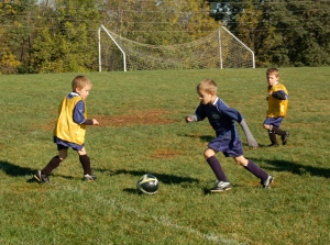 Young soccer players by Bruce Stambaugh