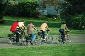 Amish boys biking by Bruce Stambaugh