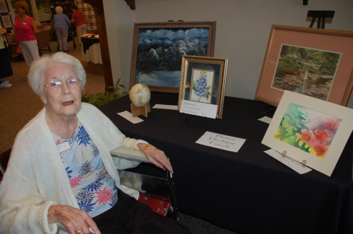 Mom with painting by Bruce Stambaugh