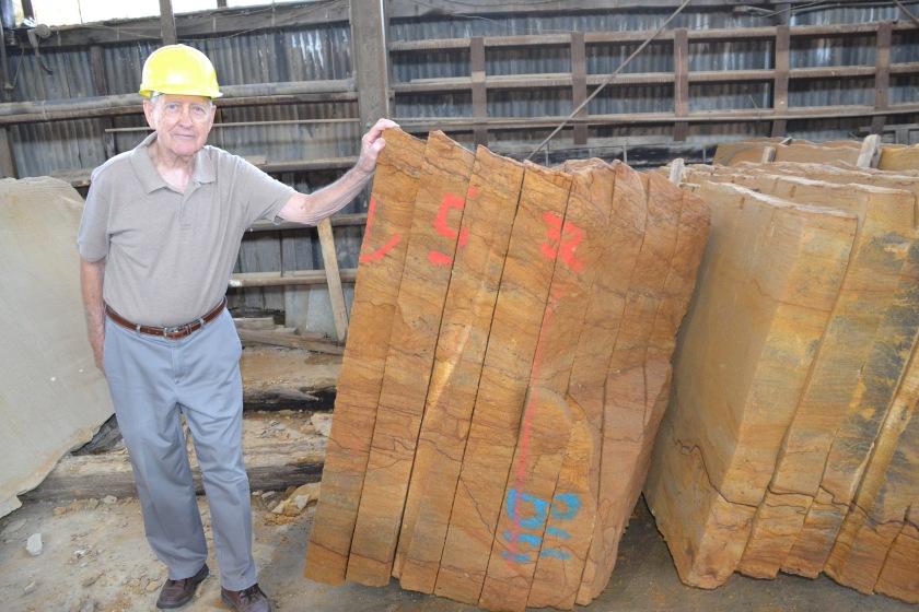 Bob Akins with stone by Bruce Stambaugh