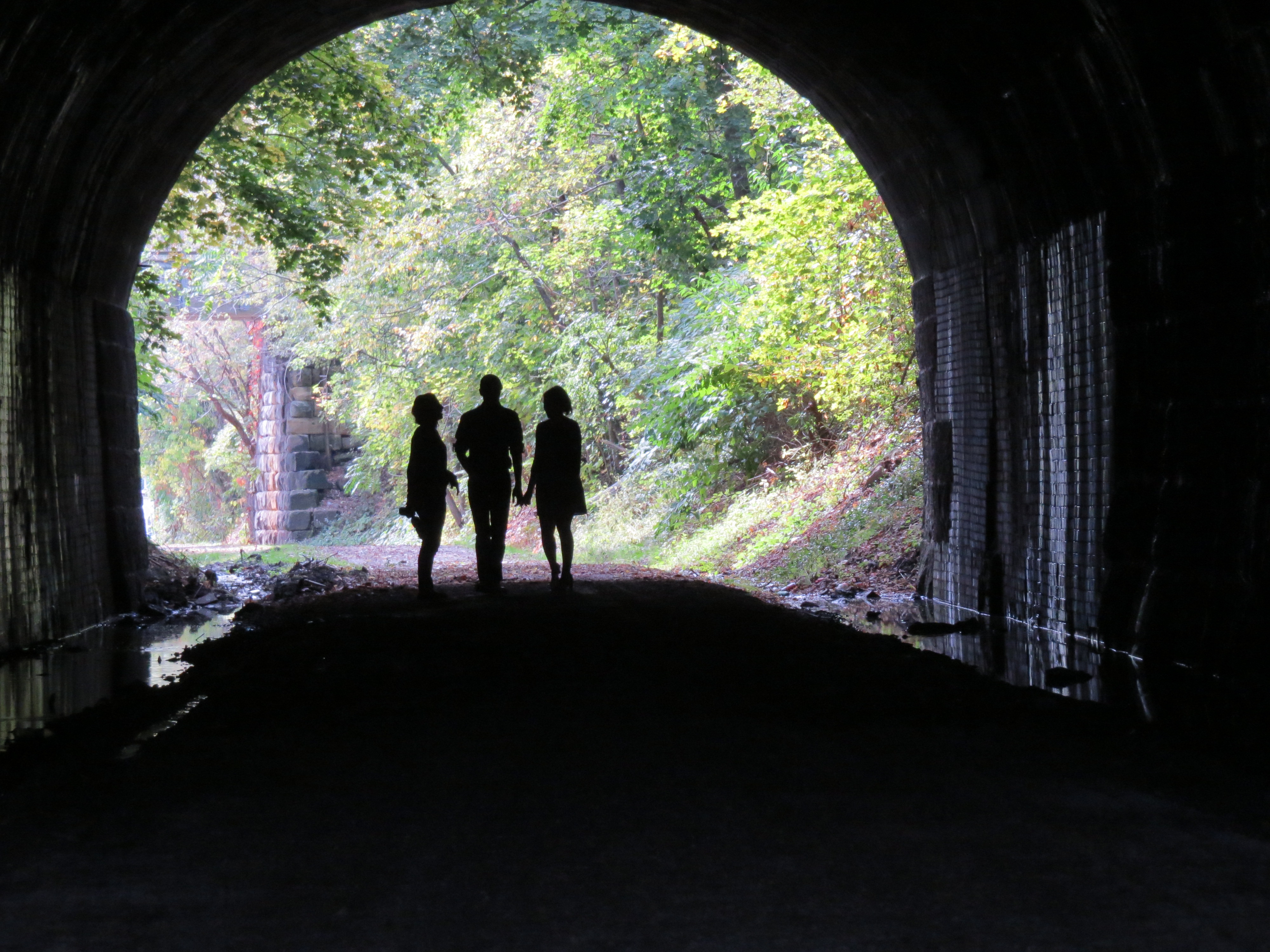 railroad tunnel, silhouettes, photographer, subjects, Bruce Stambaugh