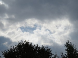 Breaks in the clouds, blue and gray skies