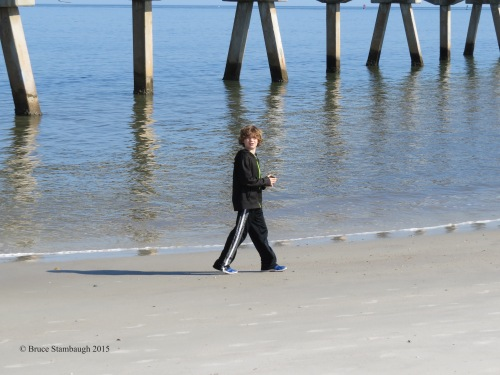 young boy, pier supports