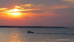 boat at sunset, wake