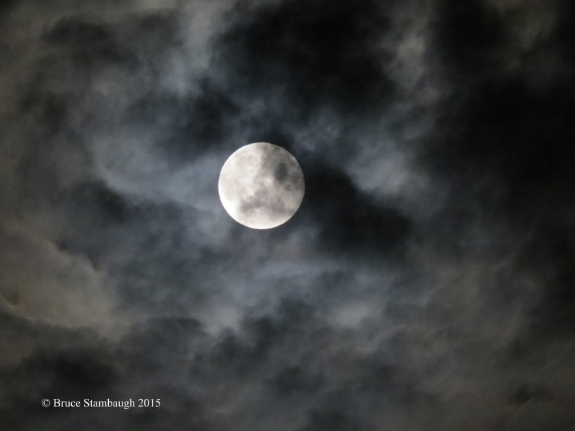 August full moon, high clouds