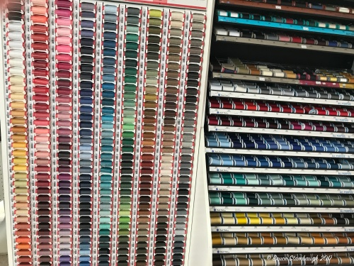 fabric store, colorful threads
