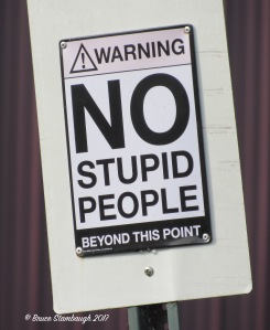 No Stupid People sign