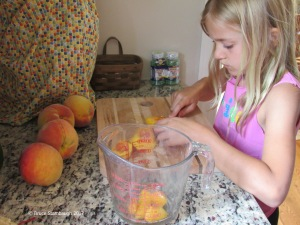 canning peaches, granddaughter