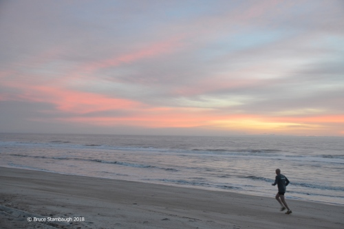 running on the beach, sunrise